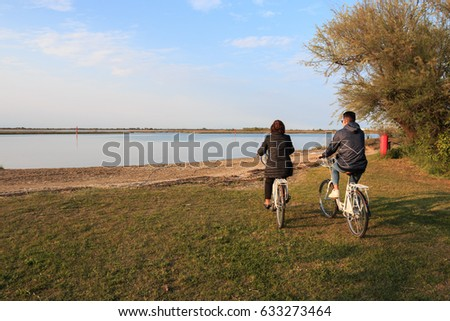 Cycling on the lagoon of Bibione