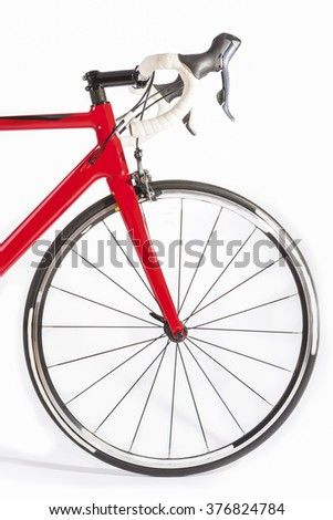 Cycling Sport Concept. Professional Road Bike Front Wheel and Handlebars Closeup. Against White. Vertical Image