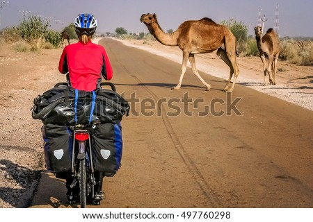 Cycling through remote desert road to Jaisalmer in India