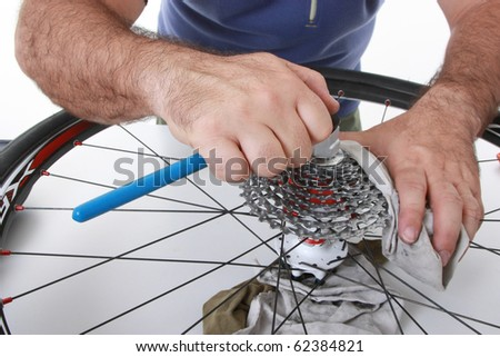 cyclist/biker taking care of his bike - stock photo