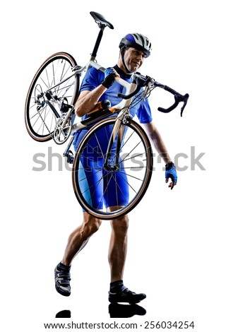 cyclist carrying bicycle in silhouette on white background
