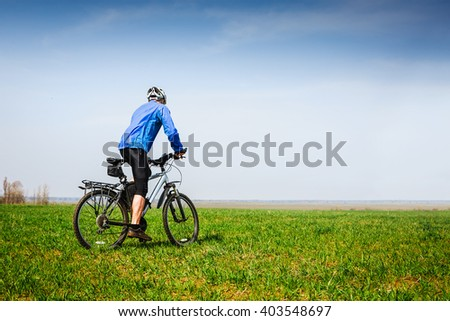 cyclist cycling in the spring park