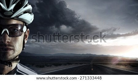 Cyclist. Dramatic close-up portrait - stock photo