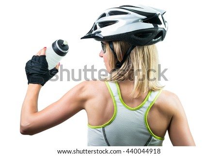 Cyclist drinking a energy sport drink from plastic bottle. Concept Winning in sports. Isolated on white background - stock photo