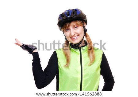 cyclist girl making a presenting gesture - stock photo