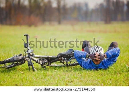 Cyclist have a rest with bike on sunny day - stock photo