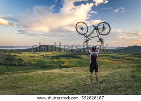 Cyclist holding up his bike