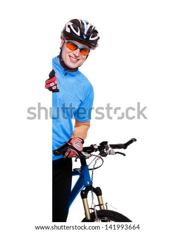 cyclist  in blue jersey holding the vertical blank board on white background and the blue bicycle - stock photo