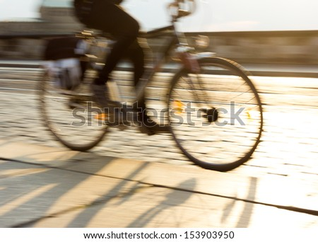 Cyclist in motion - stock photo