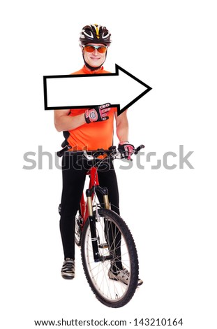 cyclist in orange jersey holding his bicycle and the pointing blank full length