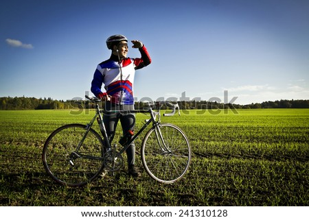 cyclist in the field - stock photo