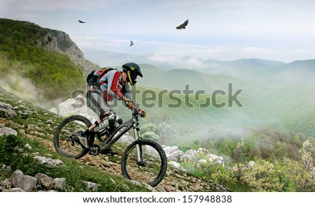 Cyclist in the mountains  - stock photo