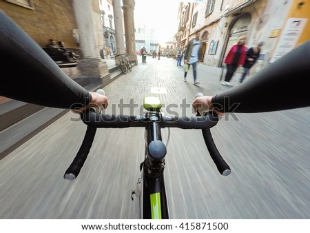 cyclist in traffic on the city roadway motion blur. POV Original point of view - stock photo