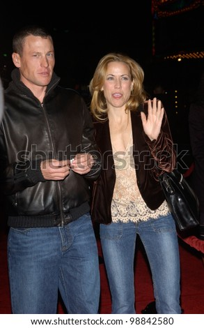 Cyclist LANCE ARMSTRONG & singer SHERYL CROW at the world premiere, in Hollywood, of Along Came Polly. January 12, 2004 - stock photo