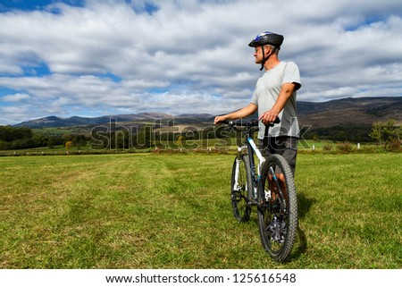 Cyclist looking for the spanish landscape - stock photo