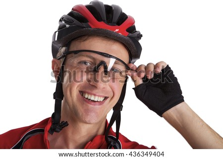 Cyclist man of Caucasian appearance. Adheres glasses hand. Wear a helmet. Studio photography. Isolated from the background. Horizontal shot. - stock photo