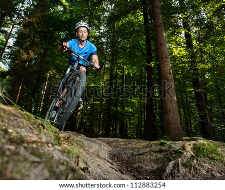 cyclist on a mountain bike - stock photo