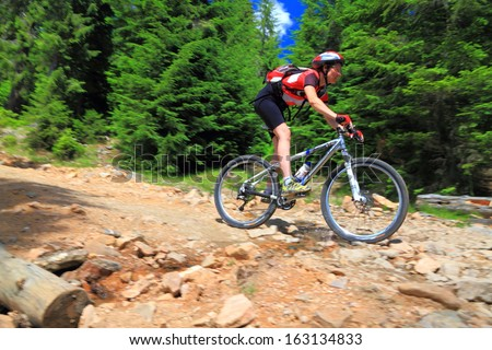 Cyclist on a mountain road during summer