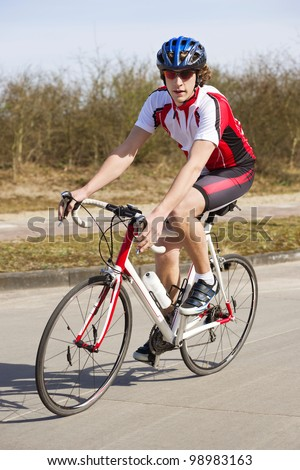 Cyclist on a racing bike, looking at the camera