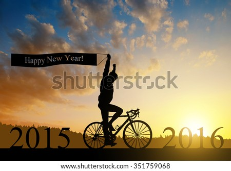 Cyclist on bicycle at sunset. Forward to the New Year 2016 - stock photo
