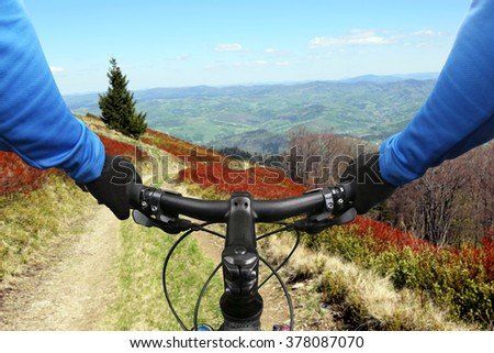 cyclist on bike rides on a mountain road - stock photo