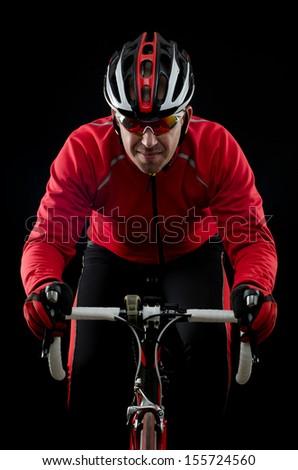 Cyclist on road bike on black background. - stock photo
