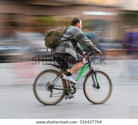 Cyclist on the city roadway in motion blur
