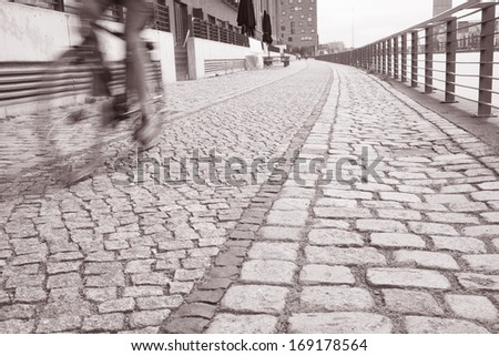 Cyclist on the Embankment of the River Spree in the Friedrichshain Neighbourhood, Berlin, Germnay