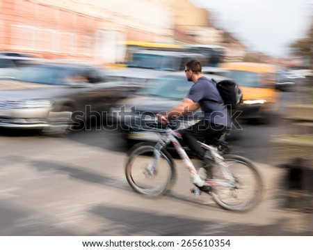 Cyclist on zebra crossing. Intentional motion blur - stock photo