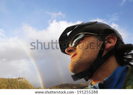 cyclist portrait with rainbows , Tuscany, Italy - stock photo
