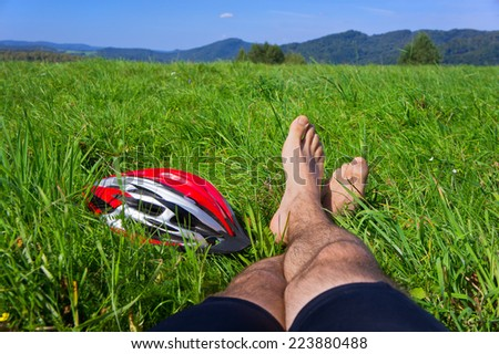 Cyclist relax. Man feet closeup of cyclist relaxing on hill enjoying sun on sunny summer day in a mountains. Poland, Bieszczady. - stock photo