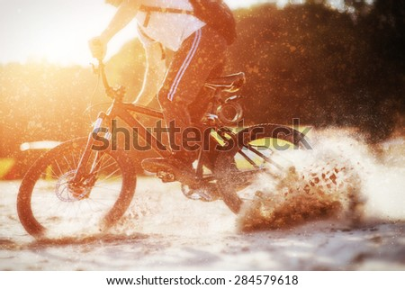 Cyclist riding a bicycle. - stock photo