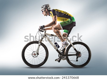 Cyclist riding a bicycle isolated against white background - stock photo