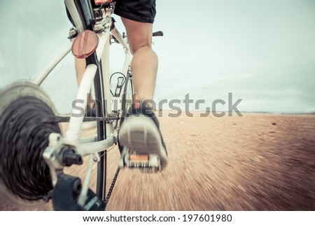 Cyclist riding bike on a trail - stock photo