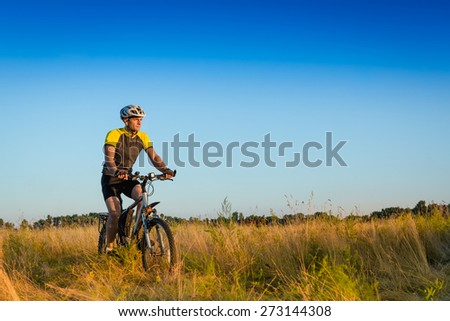 Cyclist Riding the Bike on the Beautiful Spring Trail