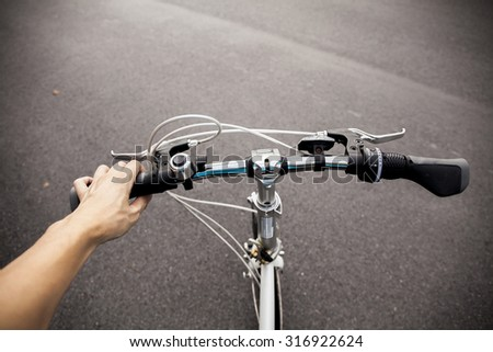 Cyclist setting out to commute on his bicycle in the parking a lot - stock photo