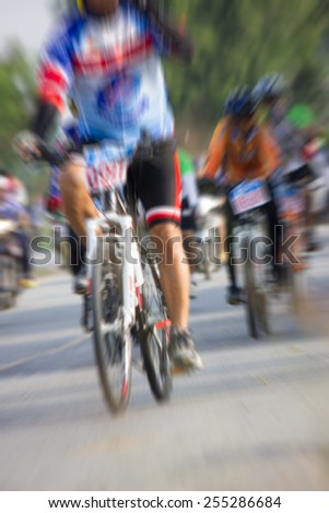 Cyclists blur.