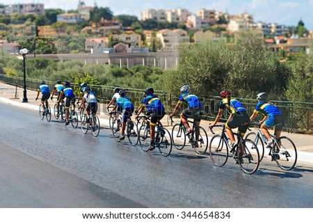 Cyclists during the race on city street. - stock photo