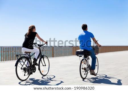 Cyclists on the seaside promenade. Seascape. - stock photo