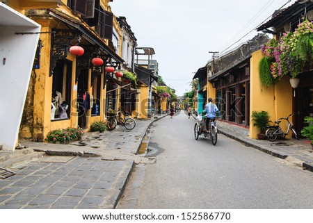 """Cyclo (called """"Xich Lo"""") in Hoi An Ancient Town, Quang Nam. Hoi An is recognized as a World Heritage Site by UNESCO. Cyclo used to be a popular transportation in Vietnam, it is for tourism now. - stock photo"""