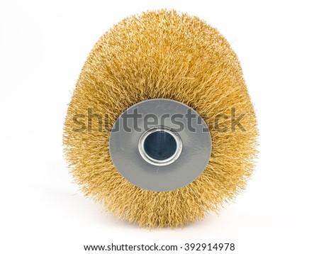 cylindrical metal brush for rotating machine, on white background - stock photo