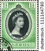 CYPRUS - 1953: A stamp printed in Cyprus shows  queen Elisabeth II in commemoration of her coronation the two on June 1953, circa 1953 - stock photo