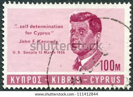 "CYPRUS - CIRCA 1965: A stamp printed in Cyprus shows president John F. Kennedy (1917-1963), citation from his speech in US Senate 13 march 1956 ""... self determination for Cyprus"", circa 1965 - stock photo"