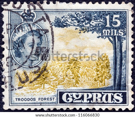 CYPRUS - CIRCA 1955: A stamp printed in Cyprus shows Troodos Forest and Queen Elizabeth II, circa 1955. - stock photo