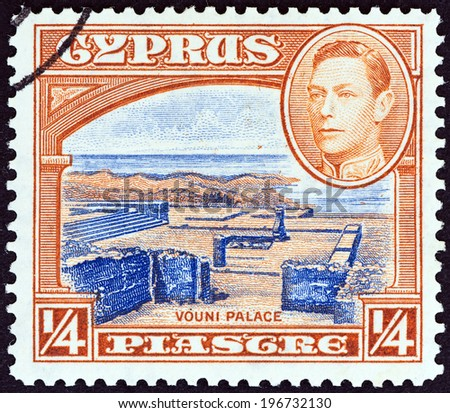 CYPRUS - CIRCA 1938: A stamp printed in Cyprus shows Vouni Palace and King George VI, circa 1938.