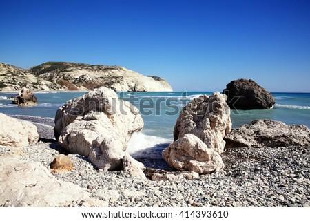 Cyprus coastline shoreline bay close to Aphrodite's Rock showing the Mediterranean sea with a blue sky and sea - stock photo