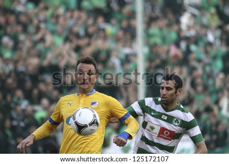 CYPRUS,NICOSIA-JANUARY 19:Gustavo Manduca  and Yiouval Spoungin Cypriot el clasico between Apoel and Omonoia for the cypriot championship at Gsp stadium in Nicosia on January 19,2013