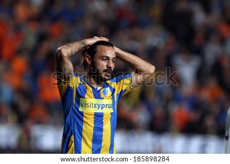 CYPRUS,NICOSIA - NOV 7:Apoel FC player Stathis Aloneftis  against Bordeaux during their Europa League  soccer match at GSP stadium in Nicosia, Cyprus, Thursday, Nov. 07, 2013