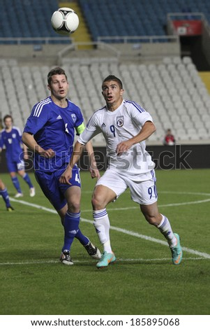 CYPRUS,NICOSIA - NOV 14:Demitris CHRISTOFI and Joona Toivio during the game between Cyprus and Finland for an international friendly match at Gsp Stadium in Nicosia on November 14th,2012 - stock photo