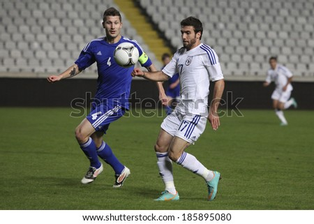 CYPRUS,NICOSIA - NOV 14:Joona Toivio and George EFREM  during the game Cyprus against Finland for an international friendly match at Gsp Stadium in Nicosia on November 14th,2012 - stock photo